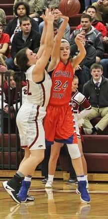 Lorin Powell (24) guarded by McCracken County's Sarah Adams, scored 11 points in the Lady Marshals win.