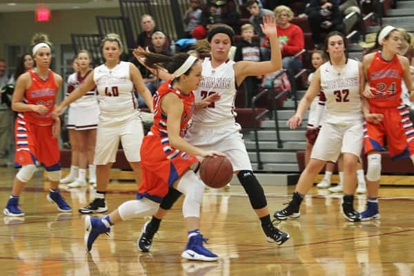 Marshall County's Chloe Kerrick works around defender Mackenzie Blackford in the Lady Marshals win over the Lady Mustangs.