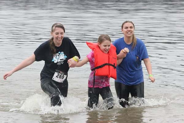 Heading out of the chilly waters of Kentucky Lake at the 7th Annual Polar Plunge is (L-R) Leigh Toby, Sophie Donahoo and Maury Greer.