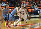 Tera Colson, defended by Calloway's Megan Greer, bringing the ball down court for the Lady Marshals.