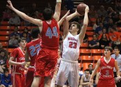 Tyler Stokes shoots over Calloway's Payton Johnson (44) in Thursday's 4th District Tournament Championship game.