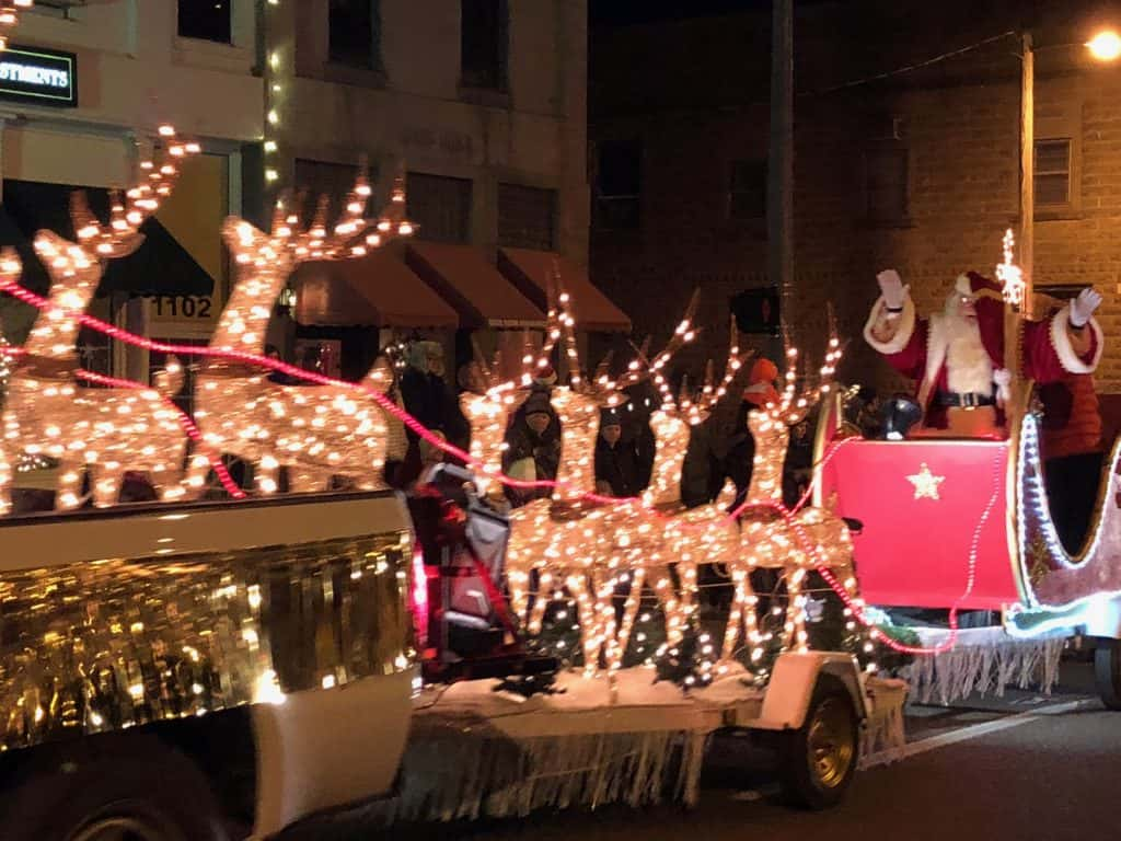 santa rides through town with his lighted reindeer to close out the christmas parade and 10th annual dickens festival saturday in benton - Dickens Christmas Festival