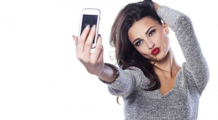 Image result for woman taking selfie