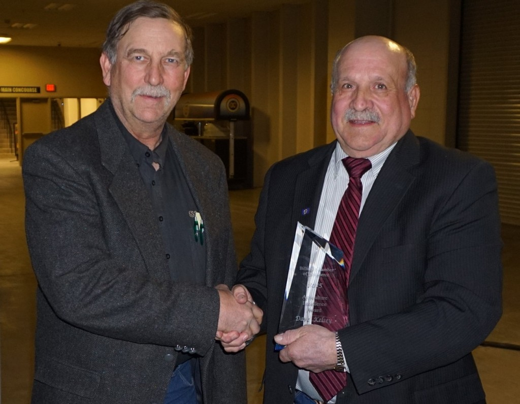 Curt Cotton, VP of Agriculture Lending with Stockman Bank presents Dave Kelsey the Ag Excellence Award.