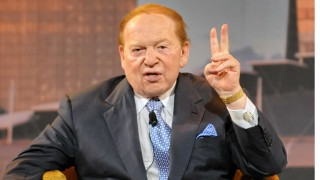 US gaming tycoon Sheldon Adelson gestures during a press conference at the Marina Bay Sands complex in Singapore on June 23, 2010.  Asians' love of gambling is so strong that the equivalent of five Las Vegases in the region will not be enough to satisfy demand, US gaming tycoon Sheldon Adelson said.    AFP PHOTO/ROSLAN RAHMAN (Photo credit should read ROSLAN RAHMAN/AFP/Getty Images)
