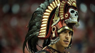 LAS VEGAS, NV - MARCH 15:  San Diego State Aztecs mascot Aztec Warrior appears on the court during the first half of a semifinal game of the Reese's Mountain West Conference Basketball tournament against the New Mexico Lobos at the Thomas & Mack Center on March 15, 2013 in Las Vegas, Nevada. New Mexico won 60-50.  (Photo by Jeff Bottari/Getty Images)