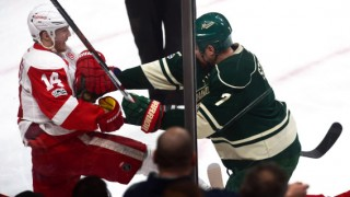 Minnesota's Chris Stewart, right, retaliates against Detroit's Gustav Nyquist, after Nyquist speared the Wild's Jared Spurgeon in the face mask with his stick in the first period. (Pioneer Press: staff photo)