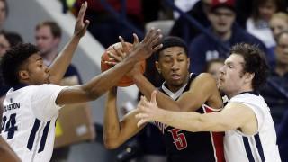 JoJo McGlaston (24) and David Collette (13) of Utah State defend Christian Wood (5) of UNLV during NCAA basketball in Logan, Tuesday, Feb. 24, 2015.