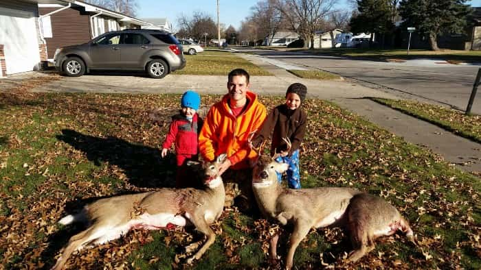 Josh Becker (center) with helpers Tyson and Gage.