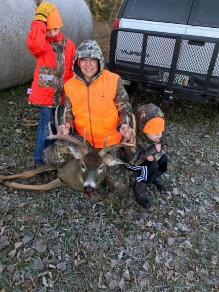 Gina Pospichal and AJ and Bo with whitetail buck shot opening morning