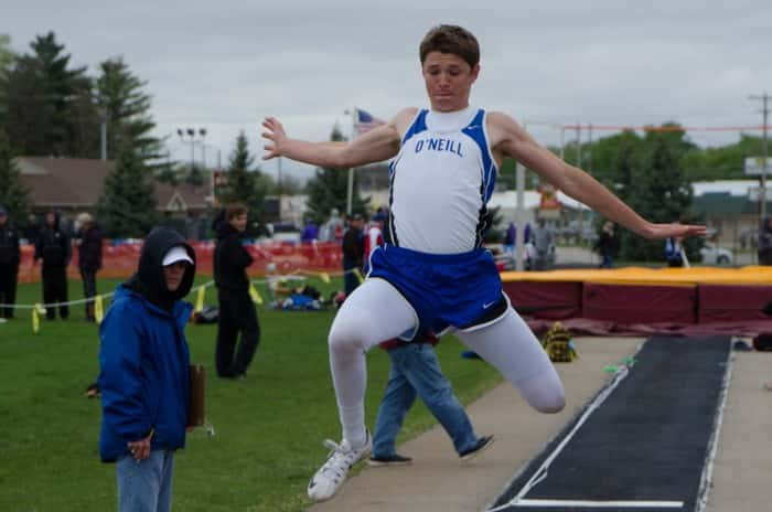 Alex Thramer competing in the Long Jump. Photo courtesy Mike Peterson