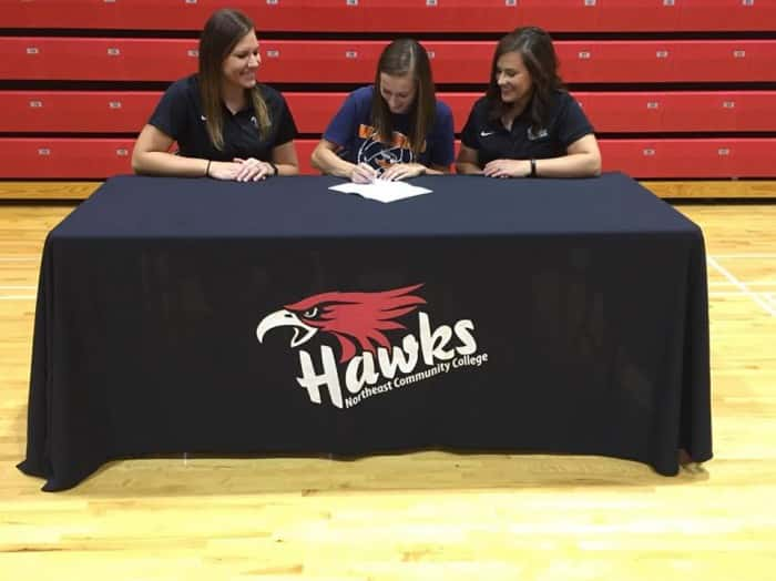 Makenzie Wecker signs her letter of intent to play volleyball in the Fall of 2017 at Midland University. She is joined by NECC Assistant Coach Sarah Oligmueller and Hawks Head Coach Amanda Schultze