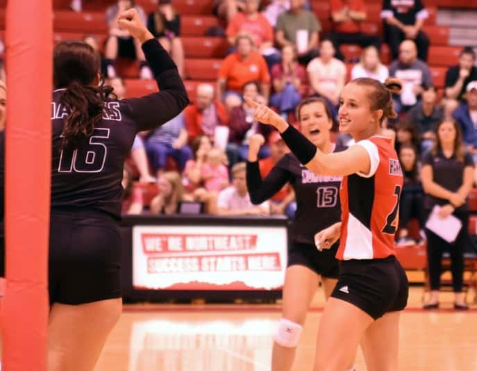 Mackenzie Wecker (right) of the Northeast Community College volleyball team celebrates with teammates  during the first set of the Hawks' season opener against Concordia JV at the Cox Activities Center in Norfolk. The Hawks defeated Concordia in three sets, scoring 25-19, 25-20 and 25-21. (Courtesy Northeast Community College)