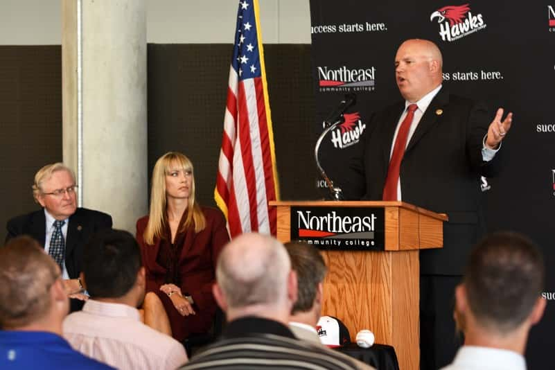 Jake Ripple, athletic director at Northeast Community College, speaks at a news conference Monday to announce that Northeast will add baseball to its intercollegiate athletic line-up beginning in the 2017-18 academic year. It will become the eight athletic program at Northeast. Dr. Michael Chipps, president, and Amanda Nipp, vice president of student services, are seated to Ripple's right. (Courtesy Northeast Community College)