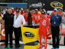 Mr. Jim Campbell of Chevrolet GM and Chip Ganassi of Target Chevrolet Racing receiving the Manufactures Trophy for winning the race with Kyle and MIS Track President Roger Curtis