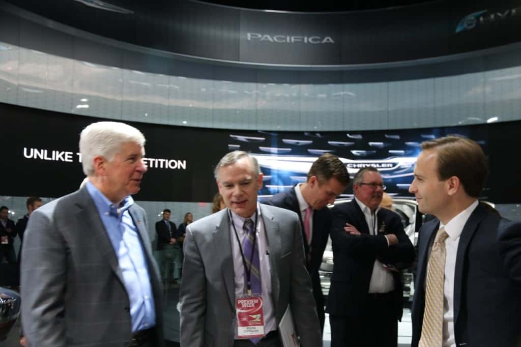 Governor Rick Snyder, Fiat-Chrysler's Mark Chernoby, and Lieutenant Governor Brian Calley share a moment at the auto show
