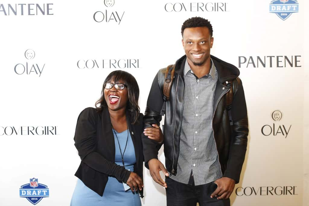 IMAGE DISTRIBUTED FOR P&G - Eli Apple, a cornerback from Ohio State, and his mother Annie Apple laugh as they take photos outside of the P&G VIP Style Lounge, on Wednesday, April 27, 2016 in Chicago. (Alyssa Schukar/AP Images for P&G)