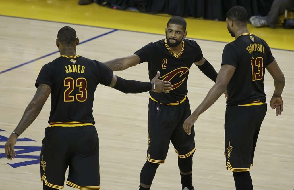 Cleveland Cavaliers guard Kyrie Irving (2), forward LeBron James (23) and center Tristan Thompson (13) react during the second half of Game 5 of basketball's NBA Finals against the Golden State Warriors in Oakland, Calif., Monday, June 13, 2016. (AP Photo/Marcio Jose Sanchez)