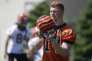 Cincinnati Bengals quarterback Andy Dalton participates in NFL football practice, Tuesday, May 24, 2016, in Cincinnati. With his broken right thumb healed, Dalton is back running the Bengals' offense during offseason workouts. (AP Photo/John Minchillo)