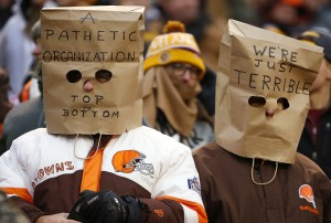 Cleveland Browns fans wear bags on their heads during an NFL football game against the Pittsburgh Steelers in Cleveland, Ohio Sunday, Jan. 3, 2016. (Winslow Townson/AP Images for Panini)