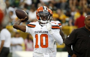 Cleveland Browns quarterback Robert Griffin III (10) warms up before an NFL preseason football game against the Green Bay Packers in Green Bay, Wis. Friday, Aug. 12, 2016. (AP Photo/Mike Roemer)