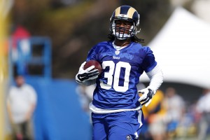Los Angeles Rams running back Todd Gurley carries the football during the NFL football team's training camp, Saturday, July 30, 2016, in Irvine, Calif. (AP Photo/Ryan Kang)