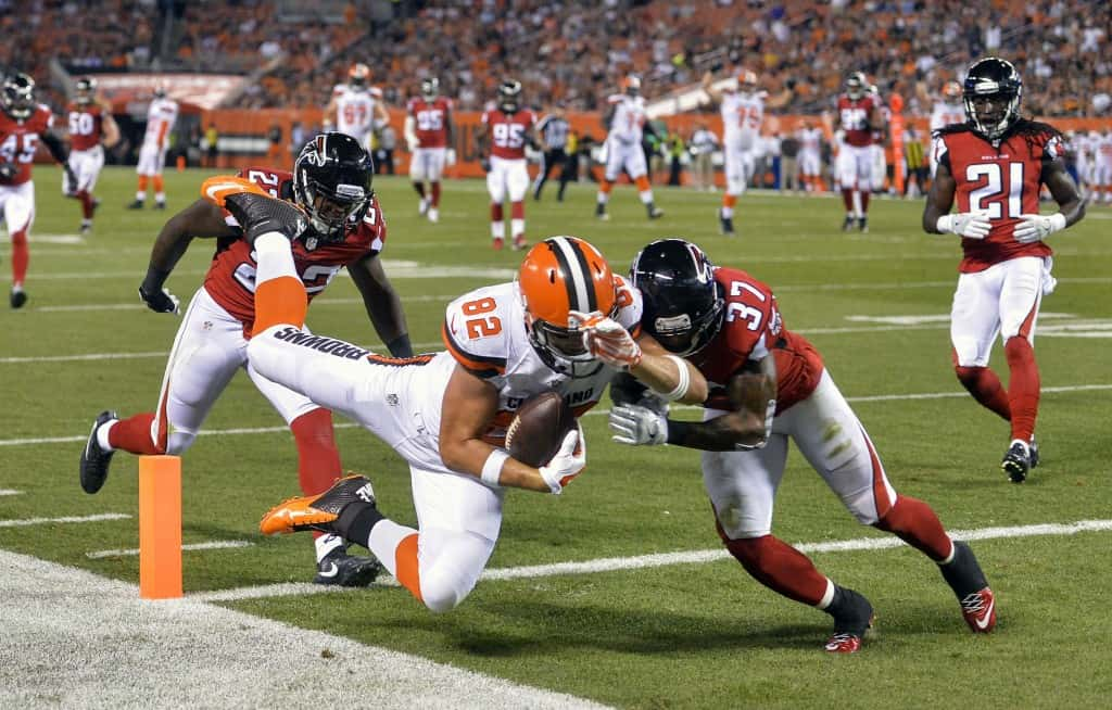 Cleveland Browns tight end Gary Barnidge (82) dives for a touchdown against Atlanta Falcons free safety Ricardo Allen (37) as strong safety Keanu Neal (22) and cornerback Desmond Trufant (21) pursue him  in the first half of an NFL preseason football game, Thursday, Aug. 18, 2016, in Cleveland. (AP Photo/David Richard)