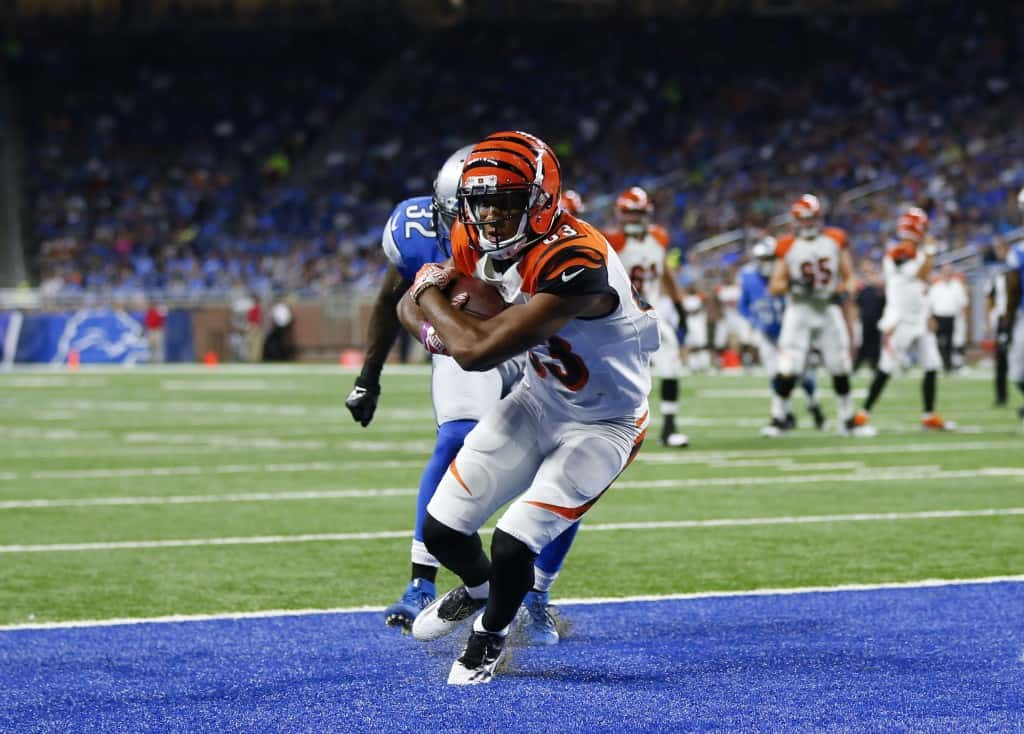 Cincinnati Bengals wide receiver Tyler Boyd (83) catches a 12-yard touchdown pass as Detroit Lions defensive back Tavon Wilson (32) defends in the first half of an NFL preseason football game in Detroit, Thursday, Aug. 18, 2016. (AP Photo/Rick Osentoski)