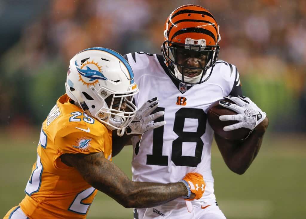 Cincinnati Bengals wide receiver A.J. Green (18) runs the ball against Miami Dolphins cornerback Xavien Howard (25) during the first half of an NFL football game, Thursday, Sept. 29, 2016, in Cincinnati. (AP Photo/Gary Landers)