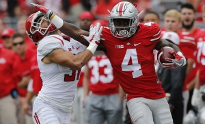 Ohio State running back Curtis Samuel, right, stiff arms Rutgers defensive back Anthony Cioffi during the first half of an NCAA college football game Saturday, Oct. 1, 2016, in Columbus, Ohio. (AP Photo/Jay LaPrete)
