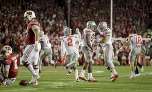 Ohio State players celebrate after defeating Wisconsin 30-23 in overtime of an NCAA college football game Saturday, Oct. 15, 2016, in Madison, Wis. (AP Photo/Andy Manis)