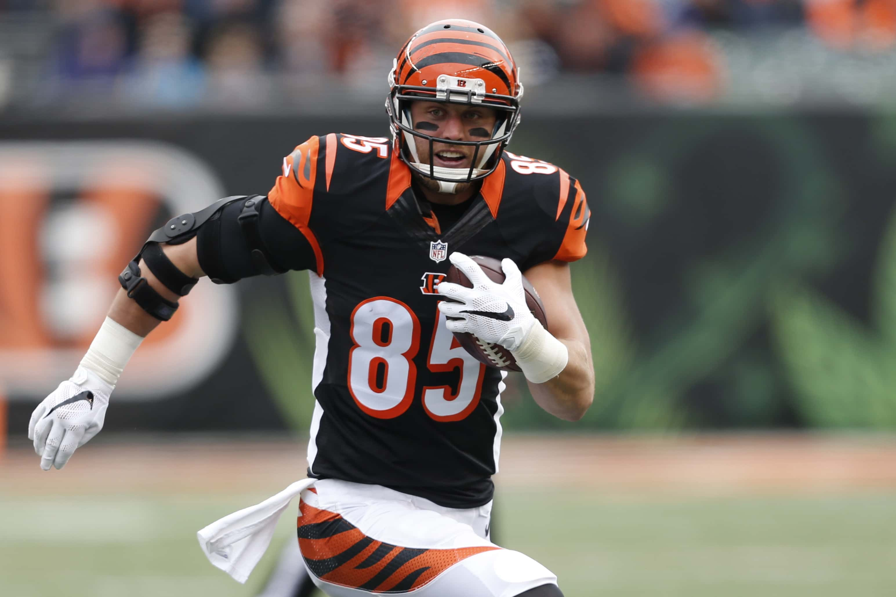 FILE - In this Nov. 29, 2015, file photo, Cincinnati Bengals tight end Tyler Eifert (85) runs the ball in the first half of an NFL football game against the St. Louis Rams in Cincinnati. Eifert had surgery on his left ankle this summer and is expected to miss most of training camp and perhaps a few games early in the season. He had one of the best seasons in club history, catching 52 passes for 615 yards and 13 touchdowns, a club record for a tight end. (AP Photo/Frank Victores, File)