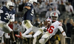 Ohio State quarterback J.T. Barrett (16) is sacked by Penn State's Jason Cabinda, behind, during the second half of an NCAA college football game in State College, Pa., Saturday, Oct. 22, 2016. Penn State won 24-21. (AP Photo/Chris Knight)