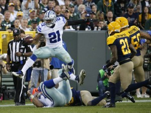 Dallas Cowboys' Ezekiel Elliott leaps over some players during the second half of an NFL football game against the Green Bay Packers Sunday, Oct. 16, 2016, in Green Bay, Wis. (AP Photo/Mike Roemer)