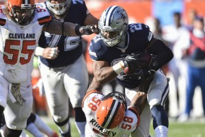 Dallas Cowboys running back Ezekiel Elliott (21) runs the ball against Cleveland Browns inside linebacker Christian Kirksey (58) in the first half of an NFL football game, Sunday, Nov. 6, 2016, in Cleveland. (AP Photo/David Richard)