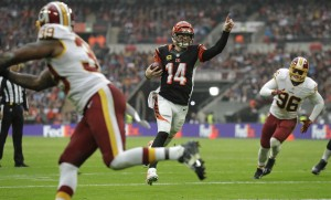 FILE - In this Oct. 30, 2016, file photo, Cincinnati Bengals quarterback Andy Dalton (14) celebrates scoring a touchdown during an NFL Football game against Washington Redskins at Wembley Stadium in London. A poor start left the Bengals lagging far behind in the AFC North. The rest of the division has come back to them, leaving it a three-way free-for-all heading into the second half. (AP Photo/Matt Dunham, File)