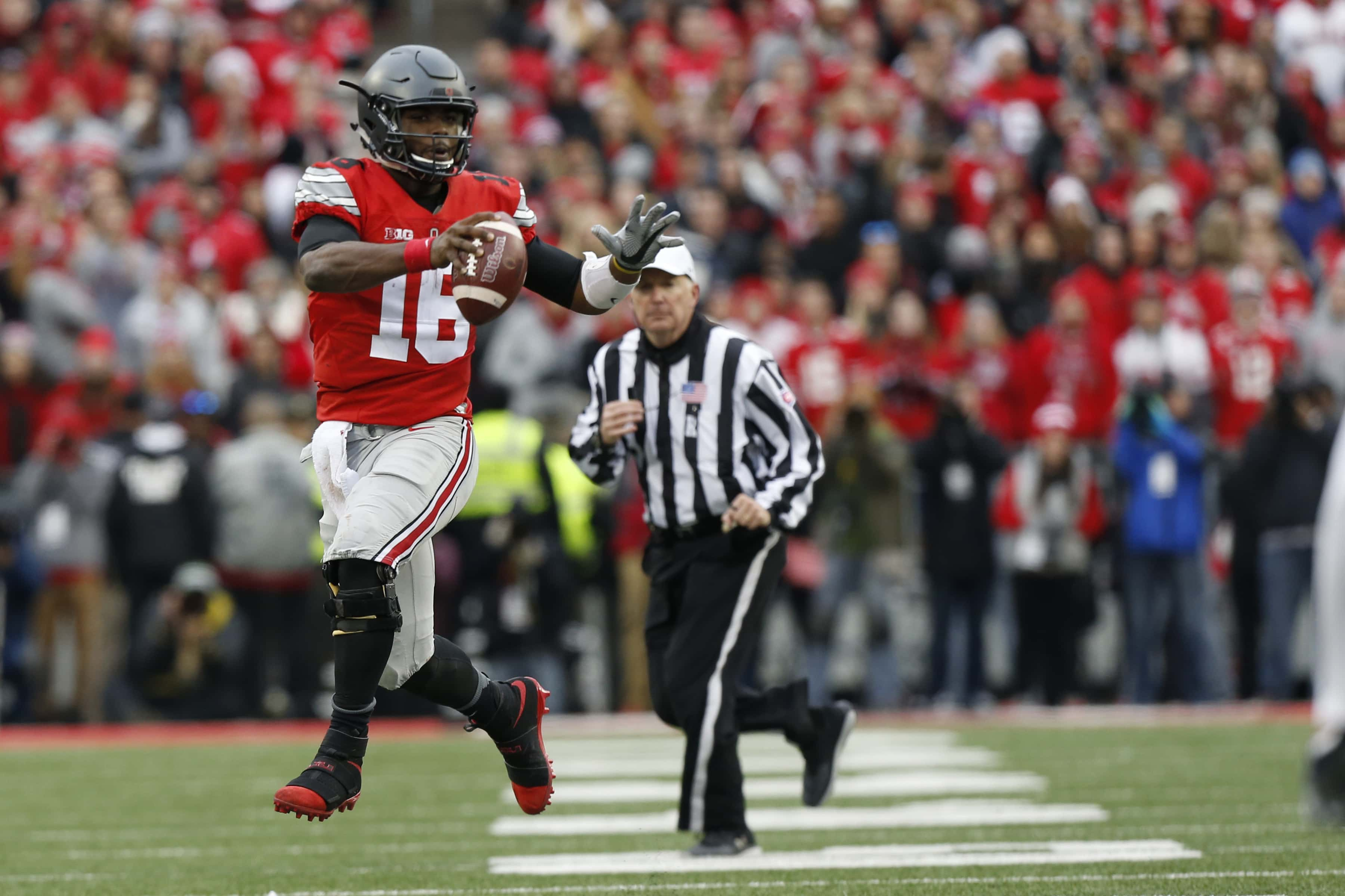 Ohio State quarterback J.T. Barrett plays against Michigan in an NCAA college football game Saturday, Nov. 26, 2016, in Columbus, Ohio. (AP Photo/Jay LaPrete)