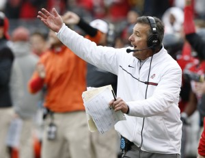 Ohio State head coach Urban Meyer shouts to his players against Michigan during the second half of an NCAA college football game Saturday, Nov. 26, 2016, in Columbus, Ohio. Ohio State beat Michigan 30-27 in overtime. (AP Photo/Jay LaPrete)