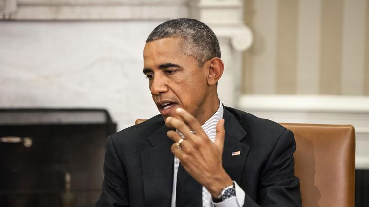 ObamaUnveilsGunControlMeasures..jpg