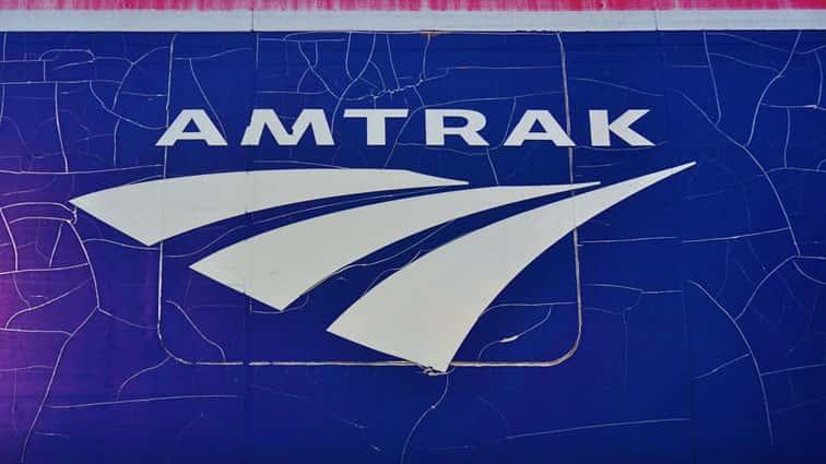 AmtrakTrainsStrikesBackhoeDerailsLeaving2Dead..jpg