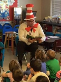 Burlington School Superintendent reading to elementary students on Dr. Suess Day.