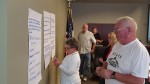West Burlington City Council members place dots on oversized sheets of paper in order to mark which issues they consider to be the city's top priorities. From L to R: Councilwoman Therese Lees, Councilman Rick Raleigh, Councilman Rod Crowner, Councilwoman Kara Steward, Mayor Hans Trousil.