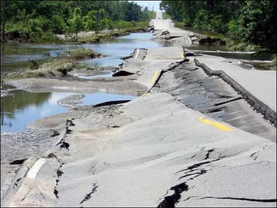 Significant damage to U.S. Highway 6 becomes apparent after the Cedar River subsides east of Atalissa.  Image from floodsafetynoaa.gov
