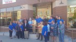 Staff, Congressmen, and board members alike cut the ribbon at the new Hopefully Yours location on Jefferson Street.