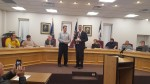 Fort Madison Mayor Brad Randolph presenting Timothy Sitting with the Chief of Police Badge # 227.