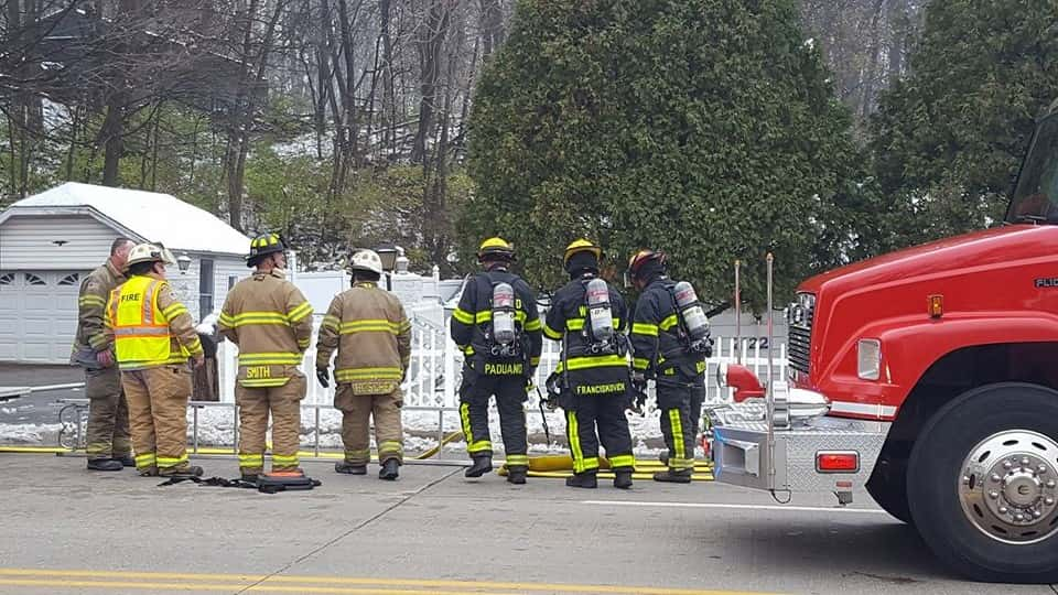 Firefighters prepare to enter the building on Monday.