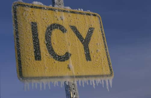 Icy Road Sign Covered with Frost & Ice Winter Alaska