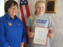 Morgan Peterson received Certificate from VFW Auxiliary President Sue Moore
