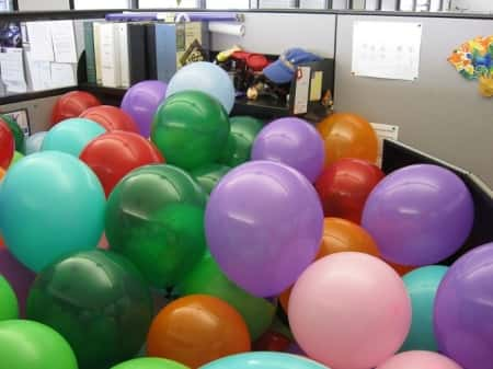 Fill someone\'s office or cubicle up with balloons.