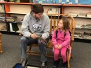 Sophomore center Alex Morrell reads to a student at Castle Heights Elementary.